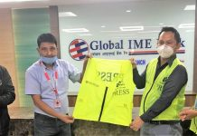 Global IME Bank Limited handover press jackets to photo journalists